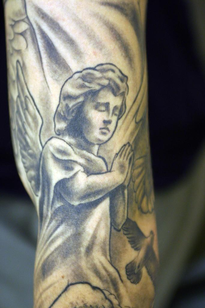 Elegant Cherub Tattoo Design 2011