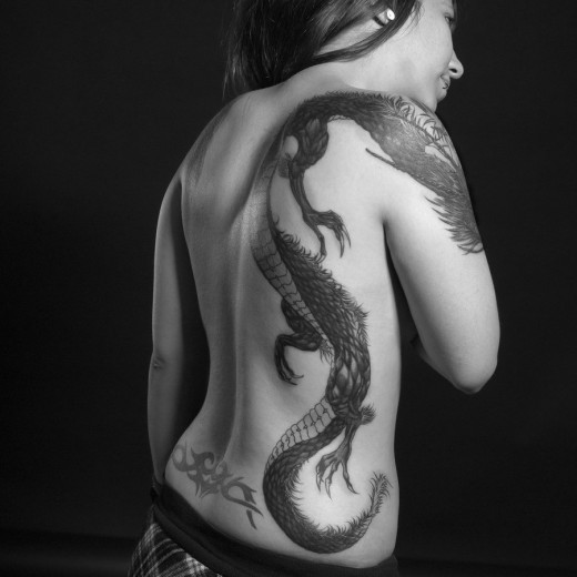 tribal dragon tattoos for girls. dragon tattoos for women on side. Black Tribal Dragon Tattoos On Side.