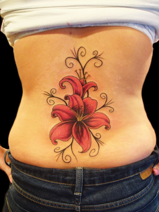 small flower tattoo designs for girls. Lily Flower Tattoo for Girls