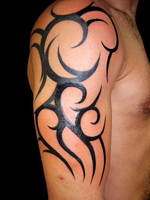 awesome tattoos designs for guys. Best Tribal Arm Tattoo Design for Guys 2011
