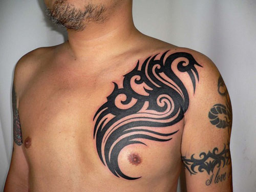 tribal tattoos for women on shoulder. Guys Shoulder Tribal Tattoo