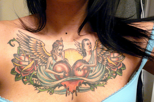 Latest Chest Piece Tattoo Art for Female 2011