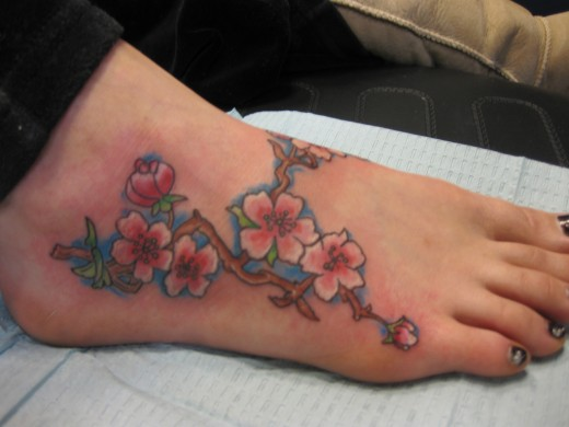 flower tattoo designs on foot. Flower Tattoo on Foot for